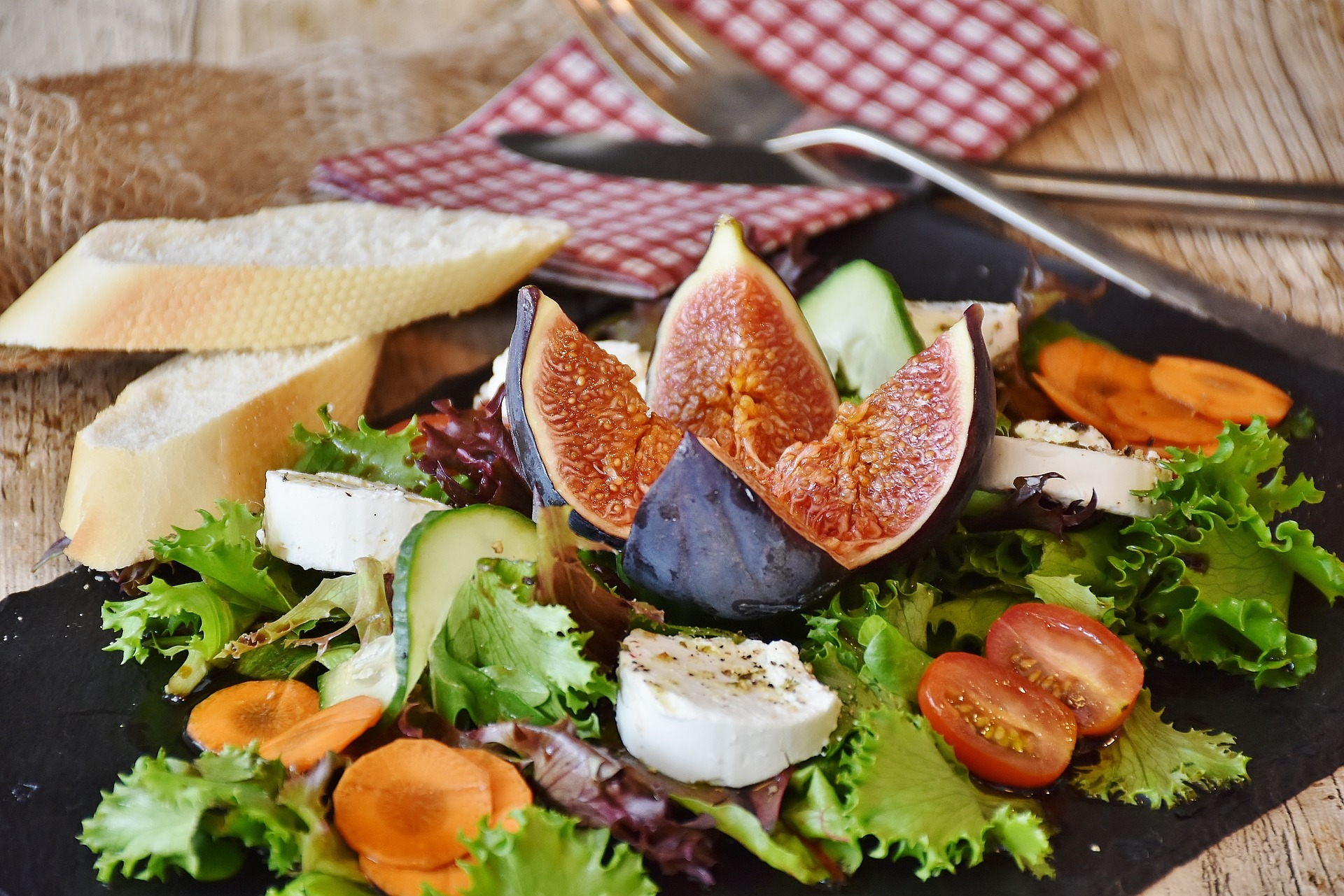 A colorful salad of fresh fruit and cheese is perfect for vegan foodies.